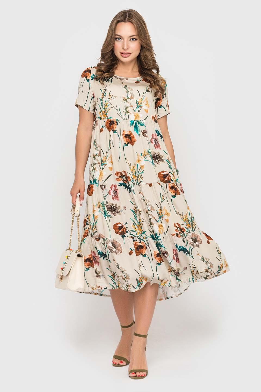 Бежевое платье с красивым цветочным принтом